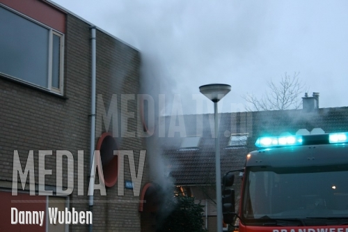 Brandje in portiek